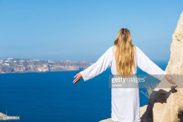 spiritual morning & woman in bathrobe - jesus is alive stock pictures, royalty-free photos & images