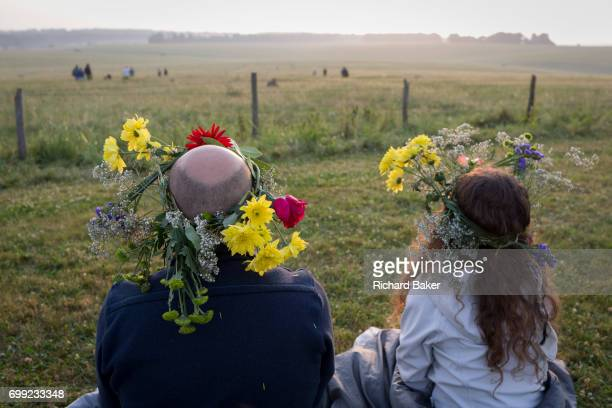 Spiritual revellers celebrate the summer Solstice at the ancient stones of Stonehenge on 21st June 2017 in Wiltshire England According to pagans the...