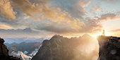 Spiritual Seeker Meditating High On Mountain Top At Sunset