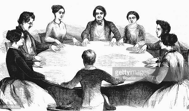 Spiritualist meeting in Leipzig, Germany, 1893. Communicating with spirits by table-turning. From L'Illustration. .
