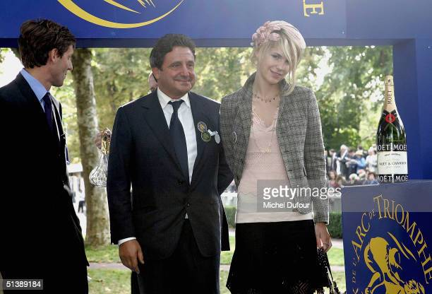Spiros Niarchos with daughter Eugenie attend the Prix de l'Arc de Triomphe at Lonchamp on October 3 2004 in Paris France
