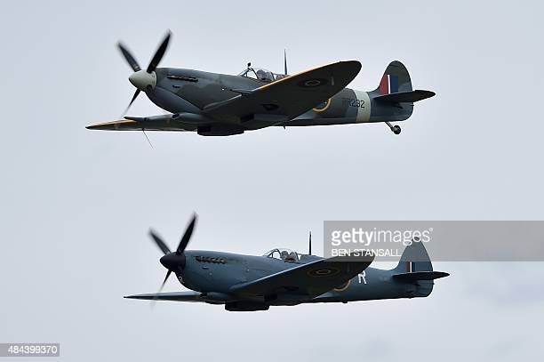 Spitfire aircraft fly over Biggin Hill airfield in Kent, on August 18, 2015. World War II aircraft including 18 Spitfires and six Hurricanes flew...
