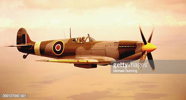 spitfire aircraft in flight (sepia tone) - spitfire stock pictures, royalty-free photos & images