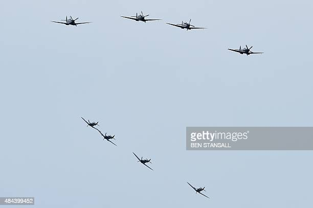 Spitfire and Hurricane aircraft fly over Biggin Hill airfield in Kent, on August 18, 2015. World War II aircraft including 18 Spitfires and six...