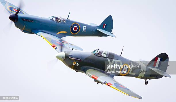 Spitfire and Hurricane in close formation at the RAFA airshow at Shoreham by Sea.
