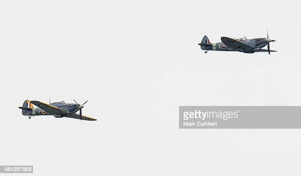 Spitfire and Hurricane planes take part in a Battle of Britain flypast on August 18, 2015 in Biggin Hill, England. A total of 18 Spitfires and six...