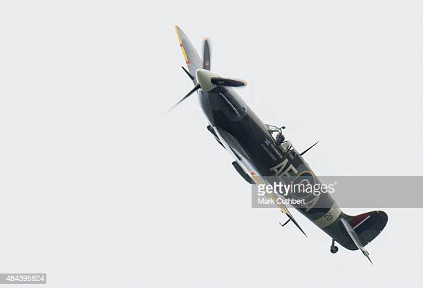 Spitfire fighter takes part in a Battle of Britain flypast on August 18, 2015 in Biggin Hill, England. A total of 18 Spitfires and six Hurricanes...