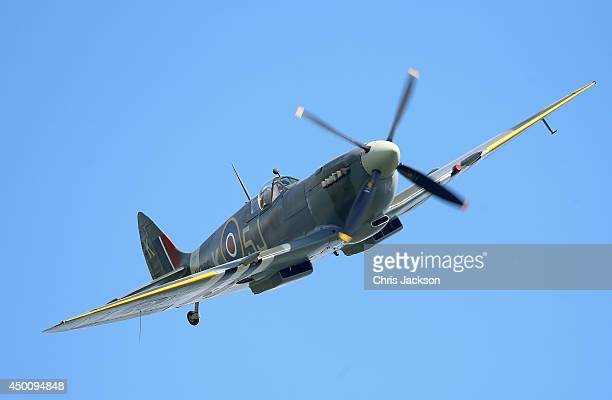 Spitfire flies over Pegasus Bridge during DDay 70 Commemorations on June 5 2014 in Ranville France Friday 6th June is the 70th anniversary of the...