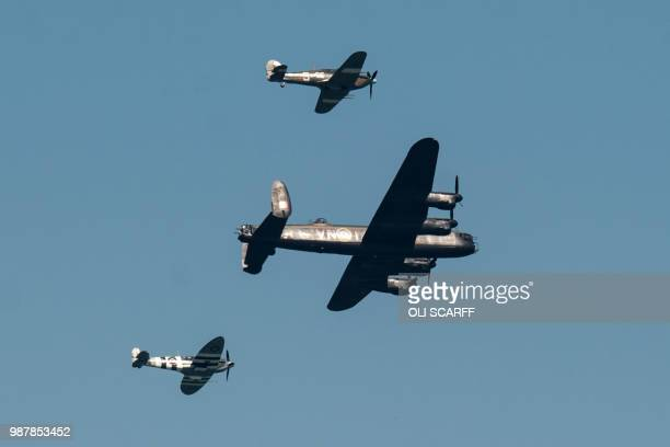 A Spitfire hurricane and a Lancaster bomber perform an aerobatic display during the national Armed Forces Day celebrations at Llandudno north Wales...