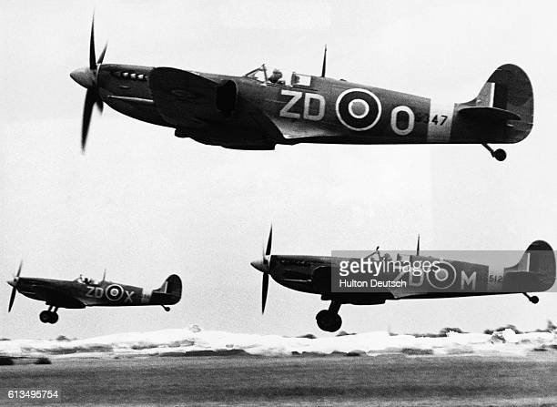 A Spitfire patrol leaves a European airbase for a sweep over Holland It is the first such squadron to be led by an Australian Wing Commander JR Ratten