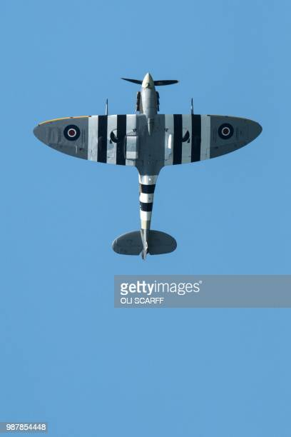 A Spitfire performs an aerobatic display during the national Armed Forces Day celebrations at Llandudno north Wales on June 30 2018 The annual event...