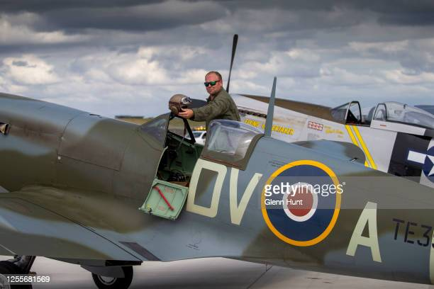 Spitfire pilot Cameron RolphSmith is seen getting out of a restored Spitfire on Brisbane's new Runway at an event to celebrate the runway's opening...