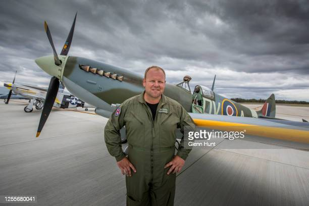 Spitfire pilot Cameron RolphSmith poses in front of a restored Spitfire on Brisbane's new Runway during an event to celebrate the runway's opening on...