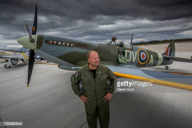 Spitfire pilot Cameron RolphSmith poses in front of a restored Spitfire on Brisbane's new Runway at an event to celebrate the runway's opening on...