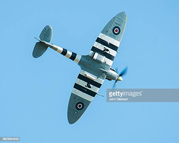 spitfire with invasion markings. - spitfire stock pictures, royalty-free photos & images