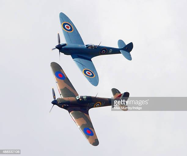 Spitfires and Hurricanes fly in formation during the 75th Anniversary of the Battle of Britain flypast at Goodwood on September 15 2015 in Chichester...