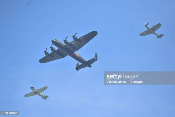 Spitfires escort a Lancaster during a flypast over Buckingham Palace in central London following the Trooping the Colour ceremony at Horse Guards...