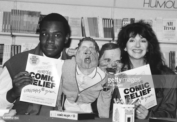 Spitting Image puppets of John McEnroe and Jefferey Archer flanked by Lenny Henry and Kate Bush at the launch of the comic relief book