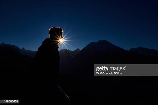 spitting sun - watzmann massif stock photos and pictures