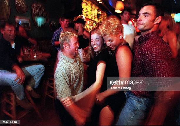 """Jacobs.Dancing.RH––070998––At the """"Old Chicago"""" bar and restaurant in downtown Boise, Greg Jacob's, left, gets down and dirty as he and teammate..."""
