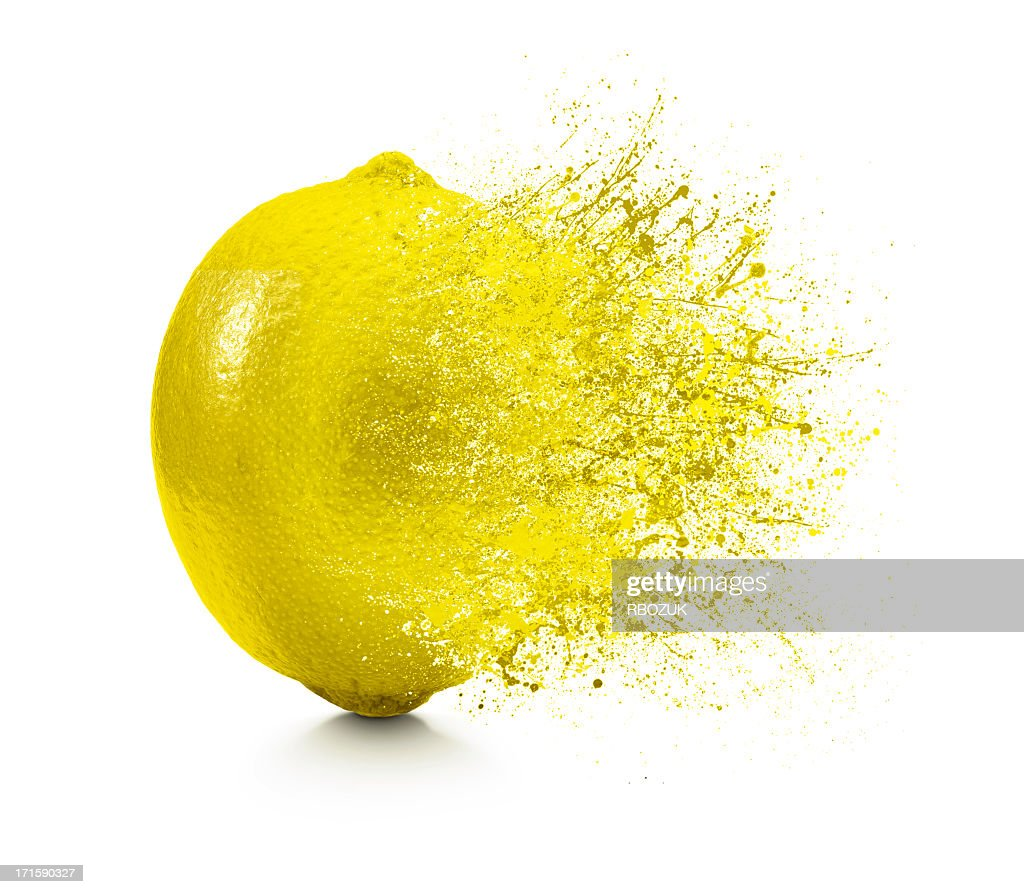 A splash coming off of a lemon on a white background : Stock Photo