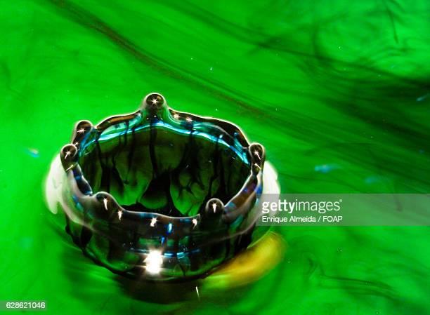 Splash crown on green background