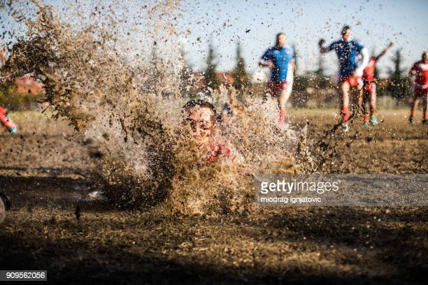 splash in mud - drive ball sports stock pictures, royalty-free photos & images