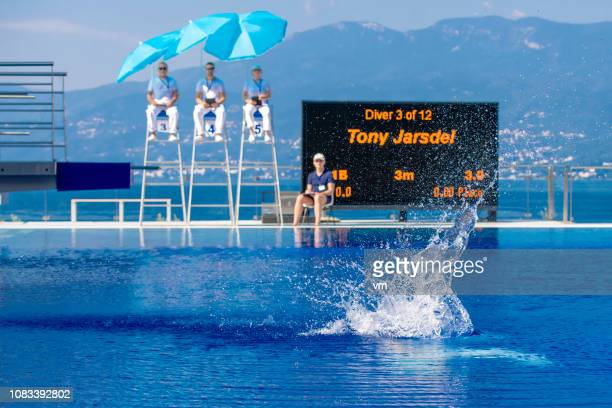 splash of a springboard diver - judge sports official stock pictures, royalty-free photos & images