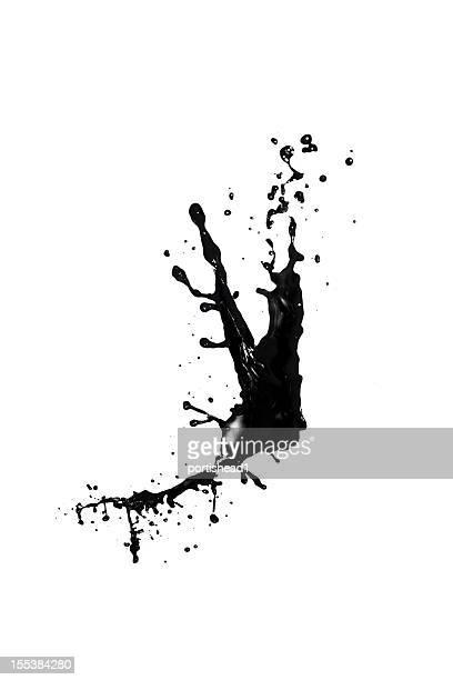 Splash of black liquid on a white background