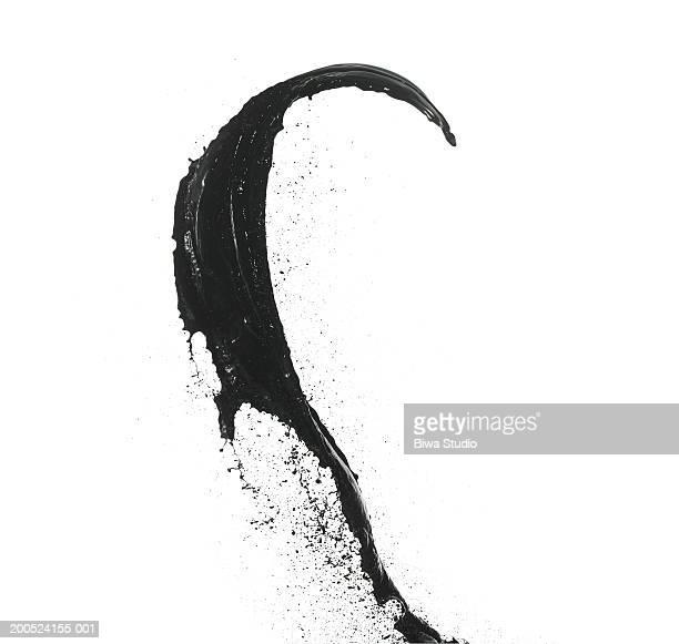 Splash of black paint on white background