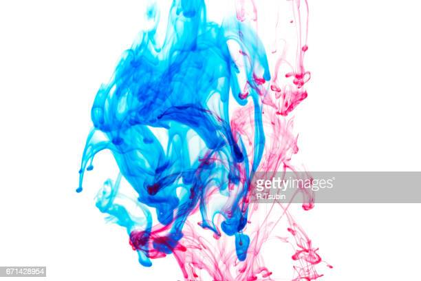 Splash of blue and red paint in water