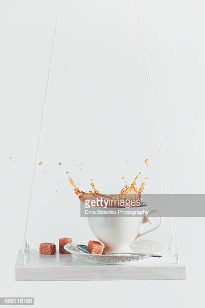 splash of morning coffee - sugar coffee stock photos and pictures