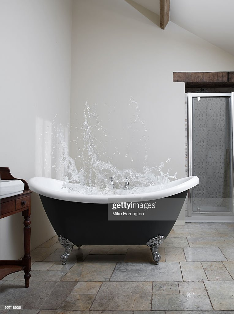 Splash Of Water In Clawfoot Bath Stock Photo   Getty Images