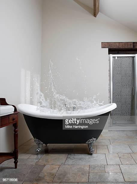 Splash of water in claw-foot bath