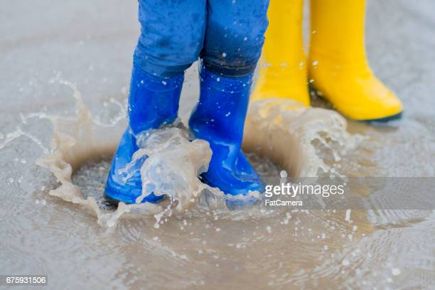 splash - yellow shoe stock photos and pictures