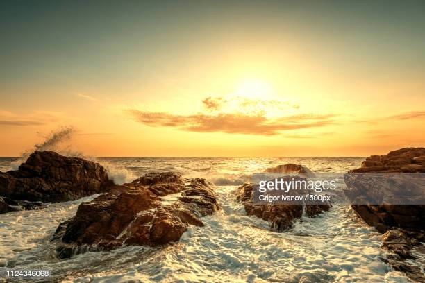 splashes of wave at sunrise - seascape stock pictures, royalty-free photos & images