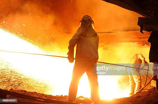 splashing of iron water - steelmaking stock photos and pictures