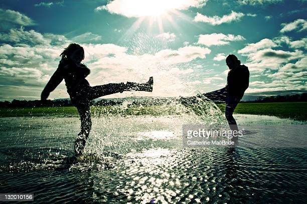 splashing out - catherine macbride stock photos and pictures