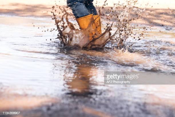 splashingboots - laars stockfoto's en -beelden