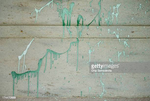 A splatter of green paint covers a large area on the statue of President Abraham Lincoln after it was vandalized at the Lincoln Memorial July 26 2013...