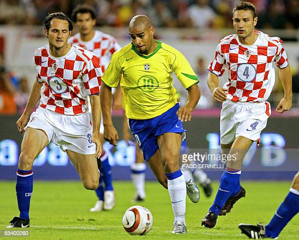 Adriano of Brazil fights for the ball with Josip Simunic and Robert Kovac of Croatia during their friendly football match Croatia/Brazil at the...
