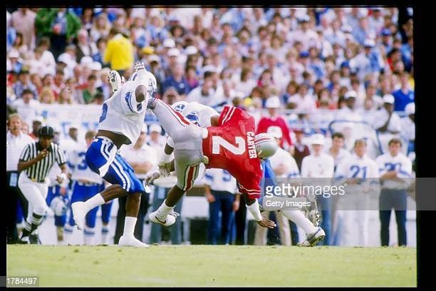 Split end Cris Carter of the Ohio State Buckeyes makes a catch during the Citrus Bowl against the Brigham Young Cougars at the Citrus Bowl in...