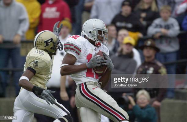Split end Michael Jenkins of the Ohio State Buckeyes hauls in the gamewinning touchdown pass in the fourth quarter over cornerback Antwaun Rogers of...