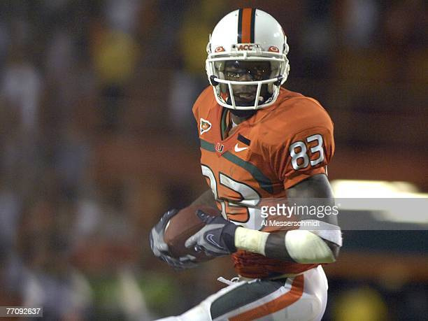 Split end Sam Shields of the University of Miami Hurricanes rushes upfield with a pass against the Texas AM Aggies at the Orange Bowl on September 20...