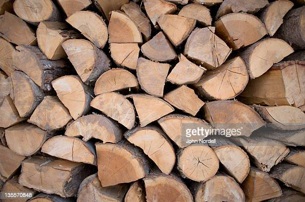 split firewood used to heat a farm house and the farm's greenhouses - firewood stock pictures, royalty-free photos & images