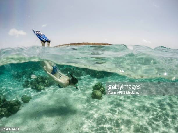 Split frame view of woman swimming in clear sea