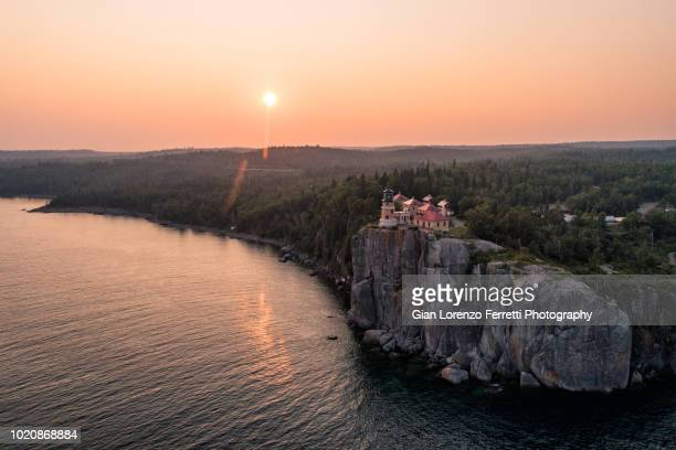 split rock lighthouse at sunset -l ake superior - duluth minnesota stock pictures, royalty-free photos & images