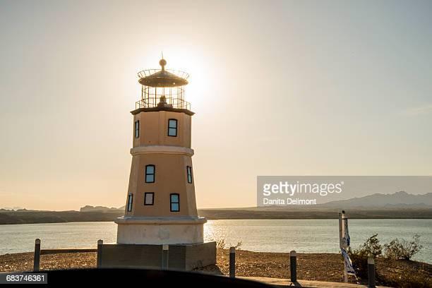 split rock lighthouse replica on havasu island at dusk, lake havasu city, arizona, usa - lake havasu stock photos and pictures