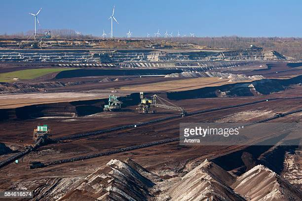 Spoil heaps and brown coal / lignite being extracted by huge bucketwheel excavators at openpit mine SaxonyAnhalt Germany