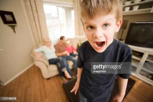 Spoiled child screaming at living room